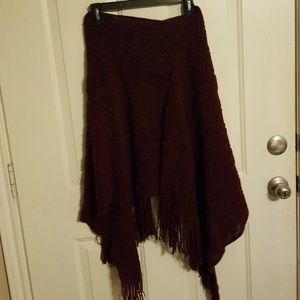 Maroon knit patterned poncho.